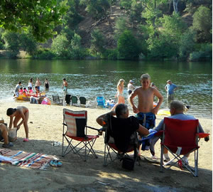 swim in the american river while attending the american river music festival, coloma, california